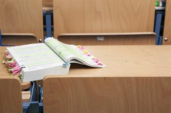 This picture shows a book in a classroom.